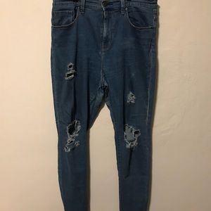 Urban Outfitters Distresses Blue Jeans